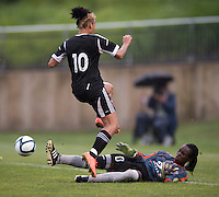 Lianne Sanderson (10) of the D.C. United Women has her shot saved by Marbel Egwuenu (0) of the Virginia Beach Piranhas during the game at the Maryland SoccerPlex in Boyds, Maryland.  The D.C. United Women defeated the Virginia Beach Piranhas, 3-0, to advance to the W-League Eastern Conference Championship.