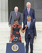 United States President Barack Obama, first lady Michelle Obama, and former U.S. Presidents Jimmy Carter and Bill Clinton arrive at the Let Freedom Ring ceremony on the steps of the Lincoln Memorial to commemorate the 50th Anniversary of the March on Washington for Jobs and Freedom<br /> Credit: Ron Sachs / CNP