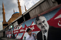 A picture of the assassinated former Prime Minister, Rafic Hariri, adorns the outside of his tomb, in Beirut, Lebanon. Hariri was killed in 2005 along with 22 others when a van loaded with 2.5 tons of explosives struck his motorcade. Many implicated Syria in the attack and his murder led to the Cedar Revolution and the withdrawal of Syrian troops from Lebanon.