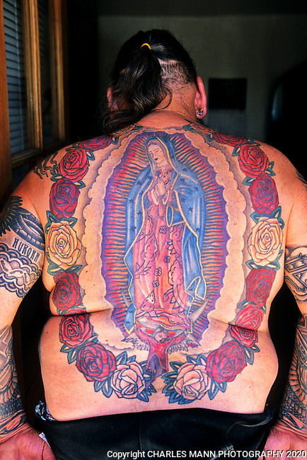 Santa Fe artist and Community Activist Ross Martinez wears his faith in art on his body in the form of some dramatic tattoos including one featuring the Virgin of Guadalupe.