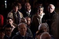 People listen to former congressman Rick Santorum at a town hall meeting in Northfield, New Hampshire.  Santorum is seeking the 2012 GOP nomination for president.