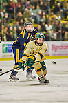 29 December 2013:  University of Vermont Catamount Forward Pete Massar, a Senior from Williston, VT, in first period action against the Canisius College Golden Griffins at Gutterson Fieldhouse in Burlington, Vermont. The Catamounts defeated the Golden Griffins 6-2 to capture the 2013 Sheraton/TD Bank Catamount Cup NCAA Hockey Tournament for the second straight year. Mandatory Credit: Ed Wolfstein Photo *** RAW (NEF) Image File Available ***