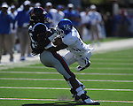 Ole Miss wide receiver Melvin Harris (5) catches a pass as Kentucky's Anthony Mosley (14) makes the tackle at Vaught-Hemingway Stadium in Oxford, Miss. on Saturday, October 2, 2010. Ole Miss won 42-35 to improve to 3-2..