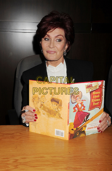 Sharon Osbourne<br /> signs copies of her new book &quot;Mama Hook Knows Best&quot; at Barnes &amp; Noble bookstore at The Grove in Los Angeles, California,<br /> USA, September 18th, 2013.<br /> half length suit white shirt black jacket sitting book <br /> CAP/ROT/TM<br /> &copy;Tony Michaels/Roth Stock/Capital Pictures