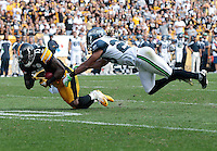 PITTSBURGH - SEPTEMBER 18:  Mike Wallace #17 of the Pittsburgh Steelers catches a pass in front of Earl Thomas #29 of the Seattle Seahawks in the second half during the game on September 18, 2011 at Heinz Field in Pittsburgh, Pennsylvania.  (Photo by Jared Wickerham/Getty Images)