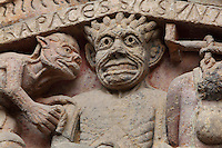 Hell, with the devil and one of his demons, early 12th century Romanesque, carved by the Master of the Tympanum, from the tympanum of the Last Judgement above the portal on the West facade of the Abbatiale Sainte-Foy de Conques or Abbey-church of Saint-Foy, Conques, Aveyron, Midi-Pyrenees, France, a Romanesque abbey church begun 1050 under abbot Odolric to house the remains of St Foy, a 4th century female martyr. The church is on the pilgrimage route to Santiago da Compostela, and is listed as a historic monument and a UNESCO World Heritage Site. Picture by Manuel Cohen