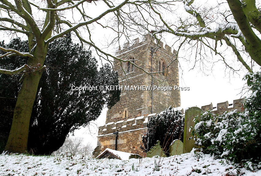 Bedfordshire - As the January cold snap makes it way down the UK, it reaches East Anglia. Villages around Bedfordshire are transformed into a winter wonderland. .Pictured - St Leonards Church and churchyard, Old Warden, Bedfordshire  - January 14th 2012..Photo by Keith Mayhew