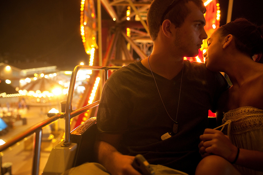 Long Beach Island, NJ - June 29, 2013 :  Nick Sinodinos, and Illy Musto celebrate their 3-month anniversary on the Ferris Wheel at Fantasy Island Amusement Park in Beach Haven on Long Beach Island, NJ on June 29, 2013. People are returning to the beaches for the summer after recovery efforts post Superstorm Sandy.