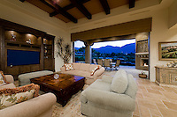 Mediterranean decore family room with beige couch in front of beautiful built-in cabinets and flat screen TV