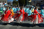 Dressed in the traditional indigenous Aymaran clothing of bowler hats, mantas or shawls and pollera dresses, cholitas dance in the streets of La Paz, celebrating a religious festival.