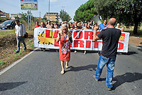Roma 20 Settembre 2014<br /> Manifestazione degli abitanti del Quartiere Ponte Di Nona e del  Unione Sindacale di Base, per chiedere l'apertura dell'asilo nido pronto da 8 anni che rimane chiuso e inutilizzato, e per la mancanza di servizi per gli abitanti del quartiere. I manifestanti bloccano via Prenestina<br /> Rome September 20, 2014 <br /> Demonstrations  of the inhabitants of the District Bridge Ninth and Union of Auditors of Base, to request the opening of the childcare  ready by 8 years which remains closed and unused, and the lack of services for local residents. Protesters block away Prenestina