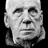 """Ron Tingay (b. UK, 1924), blinded veteran from the Second World War (WWII). """"I turned my head because I thought that my friend Wally was hit by a Japanese bullet. At that moment, a mortar grenade fell in our trench and I got hit in the face. I have been blind ever since. That was in Mandalay, Burma. I believe in predestination. If you are predestined for something like that, than you will get it. Afterwards, I proceeded against the Armstrong airplane manufacturer. I was not allowed to work there because they didn't hire blind people. I won the trial but I didn't want the job anymore. Other blind men did go to work there. I was a shoemaker for ten years and after that I worked in an ammunition factory. We made test bombs. I now have plastic eyes. They look very real. I was once talking to a woman to whom I told I have artificial eyes. She asked me if I could see well with them. To answer her, I took them out."""" .. CHECK with MRM/FNA"""