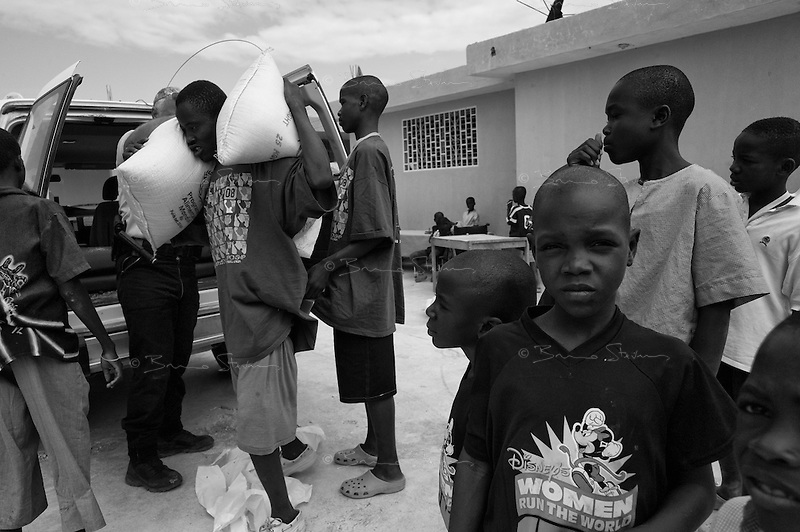 Port Au Prince, Haiti, Jan 25 2010.Everyday, the UN World Food Programme dispatches food and supplies to tens of thaousands beneficiaries such as the orfans from  the Centre d'action pour le Développement.