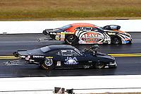 Mar 16, 2014; Gainesville, FL, USA; NHRA pro mod driver Steven Whiteley (near lane) races alongside Mike Castellana during the Gatornationals at Gainesville Raceway Mandatory Credit: Mark J. Rebilas-USA TODAY Sports