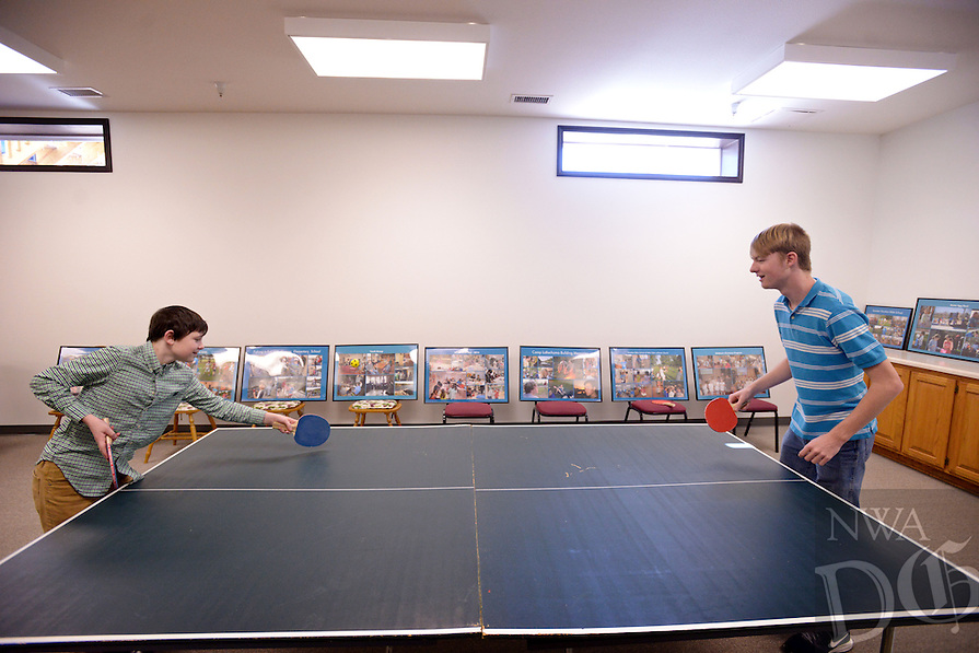 NWA Democrat-Gazette/BEN GOFF @NWABENGOFF<br /> David Hass (left), 12, of Bella Vista and Marshal Pitt of Centerton play ping pong on Sunday Nov. 8, 2015 in the teen classroom in the expansion at Bella Vista Lutheran Church. The church held a dedication ceremony Sunday for their recently completed 10,500 square foot expansion, which includes a new fellowship hall upstairs and classroom space downstairs. The project also involved the renovation of 6,500 square feet of existing space, making more room for offices and the church's food pantry.