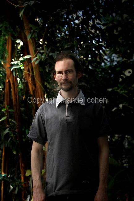 Tropical Rainforest Galsshouse, Jardin des Plantes, Museum National d'Histoire Naturelle, Paris, France. Julien Chaubeyron, a gardener in the Glasshouses.