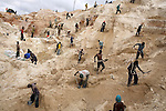 LUBUMBASHI, DEMOCRATIC REPUBLIC OF CONGO - DECEMBER 14: Some of about 4,000 artisan miners dig for copper on December 14, 2005 in Ruashi mine about 20 kilometers outside Lubumbashi, Congo, DRC. Some children as young as eight work in the mine under dangerous conditions. Every month a few of the miners are killed. Congo has one of the largest Copper deposits in the world and most of it is exported to China. It?s fueling the thirst for minerals for China?s economic boom. The young men who works in the mine makes a few US dollars a day, and the children much less. The mine is about one hundred years old and has been a source of wealth for the Katanga province for many years. In recent years many foreign companies and shady business people has moved into Congo to plunder its wealth. The country has no elected government and the corruption is rife. Border and customs officials are easily bribed. Congo has had a civil war since 1997 and it?s estimated that nearly 4 million people has died in fighting and because of lack of health care. (Photo: Per-Anders Pettersson/Getty Images)