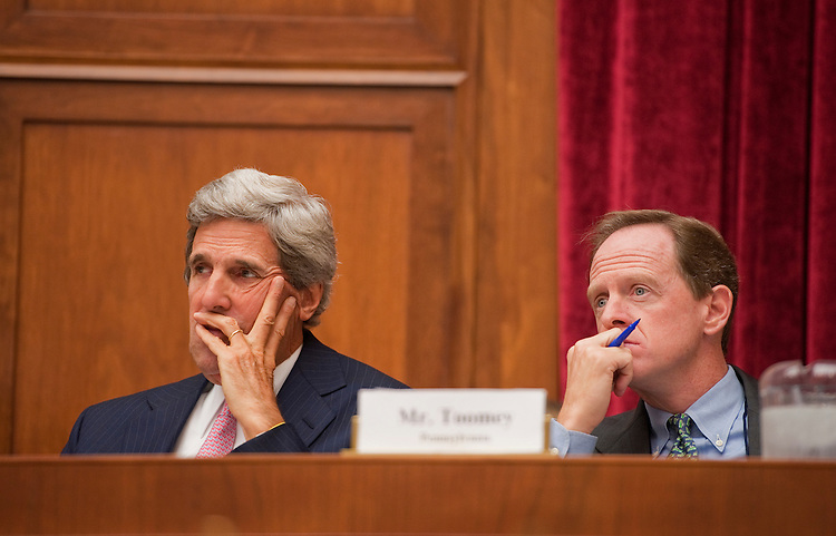 "UNITED STATES - SEPTEMBER 22:  Sens. John Kerry, D-Mass., left, and Pat Toomey, R-Pa., members of the Joint Deficit Reduction Committee, listen to testimony by Thomas Barthold, chief of staff of the Joint Committee on Taxation, during a hearing entitled ""Overview: Revenue Options and Reforming the Tax Code,"" in Rayburn Building.  (Photo By Tom Williams/Roll Call)"