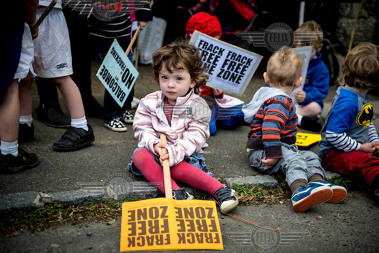 Toddlers with toddler sized protest placards during rally by residents of the West Sussex village of Balcombe to protest that Hydraulic Fracturing (fracking) company Cuadrilla Resources Ltd has been granted an exploration licence for a site close to the village. /Felix Features