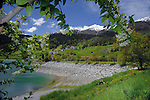 Stone banked beach, Lake Resia, Italian/ Austrian border.