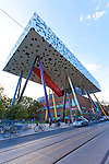 "The ""Sharp Centre for Design,"" designed by architect Will Alsop, of Alsop Architects, in a joint venture with Toronto-based Robbie/Young + Wright Architects Inc., consists of a box four stories off the ground supported by a series  of multi-coloured pillars at different angles and is often described as a tabletop. In 2004, the $42.5 million expansion and redevelopment has received numerous awards, including the first-ever Royal Institute of British Architects Worldwide Award, the award of excellence in the ""Building in Context"" category at the Toronto Architecture and Urban Design Awards, and was deemed the most outstanding technical project overall in the 2005 Canadian Consulting Engineering Awards."