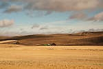 Tractors plowing the fields in the fall in the Palouse Valley in Washington