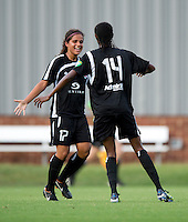 Esther Anyanwu (14) of the Virginia Beach Piranhas celebrates her goal with teammate Yasmin Bunter (17) during the game at the University of Mary Washington Battleground Stadium in Fredericksburg, VA.   The Virginia Beach Piranhas defeated the Fredericksburg Impact, 2-0, in a weather shortened game.