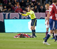 Referee Terry Vaughn calls to the Chivas USA bench to provide assistance to injured midfielder Blair Gavin (18) during the first half of the game between Chivas USA and Colorado Rapids at the Home Depot Center in Carson, CA, on March 26, 2011. Final score Chivas USA 0, Colorado Rapids 1.