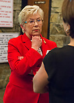 Oct. 23, 2012 - Merrick, New York, U.S. - Congresswoman CAROLYN MCCARTHY (D), in red suit, spoke at the 4th Annual Meet the Candidate Night held by civic associations of Merrick, with many in the area in a new congressional district. Later in the lobby when Representative McCarthy answered fruther questions from individuals, the woman in dark short sleeve top stated, eventually loudly, that she strongly disagreed with McCarthy's Right To Choice position on abortion.