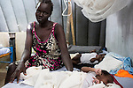 Mcc0075406 . Daily Telegraph<br /> <br /> DT Foreign<br /> <br /> Niacin Ruot with her twins Both and Nyadit who are suffering from severe malnutrition .<br /> <br /> The IMC Paediatric ward in POC 3 , a &quot;Protection of Civilian Camp&quot; inside the vast UN compound on the outskirts of Juba . Parents bring their children in with acute malnutrition needing urgent treatment .<br /> <br /> Over 20,000 civilians who predominantly fled from conflict in the equatorial states of South Sudan . United Nation's agencies recently announced a famine in the war torn country .<br /> <br /> Juba 27 February 2017