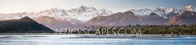 Sunrise over Southern Alps, Mount Tasman and Mount Cook with reflections in Cook River in foreground, Westland National Park, World Heritage Area, West Coast, New Zealand