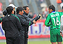 (R-L)  Fan Xiaodong,  Takeshi Okada,  Suzuki (Greentown),.FEBRUARY 25, 2012 - Football / Soccer :.Hangzhou Greentown FC head coach Takeshi Okada gives instructions to Xiaodong during a pre-season match between Omiya Ardija and Hangzhou Greentown FC at NACK5 Stadium Omiya in Saitama, Japan. Okada is a former Japan national team coach.