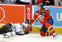 Florida Panthers' Jed Ortmeyer, right, takes out Dallas Stars' Francis Wathier during the third period of an NHL preseason hockey game, Friday, Sept. 20, 2013, in San Antonio, Texas. Dallas won 4-1. (Darren Abate/DA Media)