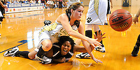 Hackleburg's Kambryia Dinkins dives for a loose ball with R.A. Hubbard's Tenisha Lynch during the NW Region Final between R.A. Hubbard and Hackleburg in Hanceville.  Photo by Gary Cosby Jr.  2/18/10.