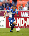 After playing for the US Women's team in an earlier game, Mia Hamm plays her second game after coming on as a substitute at RFK Stadium in Washington, DC on 4/26/03 during a game between the Atlanta Beat and Washington Freedom
