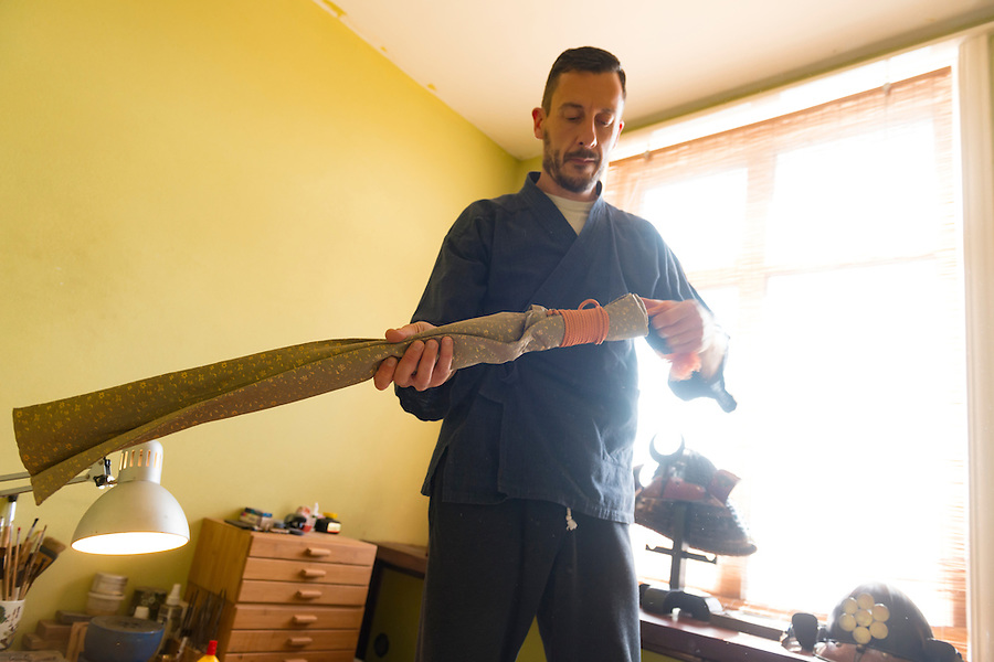 Soanes unwraps a samurai sword. Robert Soanes Japanese Armour and Antiques Restorer, Brighton, UK, May 6, 2016. Craftsman Robert Soanes specializes in the restoration and conservation of samurai armour, swords and other Japanese fine art. He lives and works in the English seaside resort of Brighton.