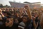 Youths raise their fists up as they demand to respect the sacred place of Wirikuta during the Wirikuta Fest in Mexico City's Foro Sol, May 26, 2012. Almost sixty thousand people attended the Fest to support the struggle of the Wixarica Native people against the trasnational mining corporations. Photo by Heriberto Rodriguez