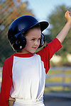 Young girl (7 years old) celebrating after getting winning hit, T ball, smiling, Woodinville, Washington USA   MR