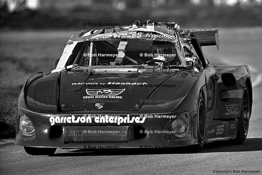 Bobby Rahal drives the Cooke Woods Racing Porsche 935 he shared with Bob Garretson and Brian Redman in 1981 at the 12 Hours of Sebring. Earlier in the race Garretson had spun, nudged into the tire wall at a shallow angle and slowly rolled over. The crew made the repairs visible in this picture, and the car finished 17th.