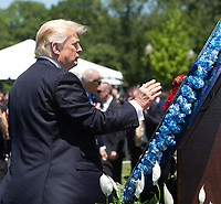 United States President Donald J. Trump places a flower on a memorial wreath at the 36th Annual National Peace Officers' Memorial Service at the US Capitol in Washington, DC, May 15, 2017. <br /> Credit: Chris Kleponis / Pool via CNP /MediaPunch