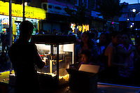 People make the line for free popcorn while they attend the National Night Out festivities in Union City, New Jersey, Aug 6, 2013. Photo by Eduardo Munoz Alvarez / VIEWpress.