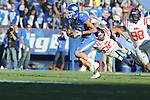 Kentucky's Matt Roark (3) is chased by Ole Miss' Cody Prewitt (25) and  Uriah Grant (98) at Commonwealth Stadium in Lexington, Ky. on Saturday, November 5, 2011. ..