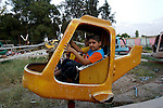 Iraqi children enjoy a ride on a dilapidated airplane at a popular amusement park in Irbil, Iraq...Stability and security prevail in postwar Iraqi Kurdistan as Iraqi tourists, many of them from Baghdad, flock to the northern cities and their amusement parks and national parks to escape violence and sectarian strife in the central and southern regions of the country.