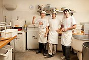 Guglhupf bakers, from left, Carl Zimmerman, Chris Astraikis and Lee Whitsel, in their element, Durham, November 30, 2011...Photo by D.L. Anderson