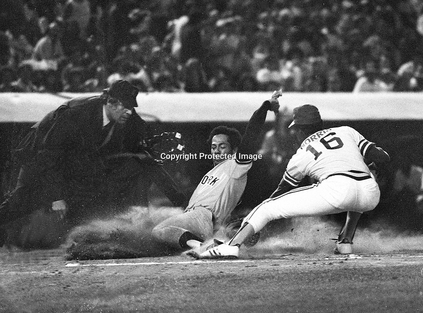 New York Yankee Roy White is tagged out at home by Oakland A's pitcher Mike Norris. (1976 photo/Ron Riesterer)