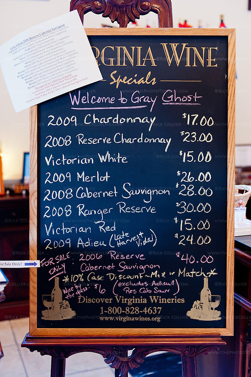 A hand-lettered chalkboard announces the wines and prices in the tasting room at Gray Ghost Vineyards.