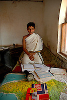 A Student of Om Shantidhama studying at his room. Om Shantidhama is a residential vedic school for boys. Nestled among the confluence of hills, forest and rivers - Om Shanti Dhama is a world removed from the maddeningly fast and often chaotic urban India. Students from allover the country are selected to take part in its Vedic and free education system. What is unique about this institute is that they have blended the traditional and modern education system. Here computer and science is taught with the same passion as the Vedas and Shastras, helping the students to grow spiritually as well as earn a living. Bonding with the nature and animal world is a mandatory part of the institute's curriculum. Karnataka, India. Arindam Mukherjee
