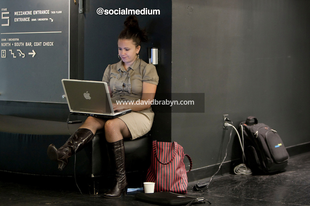 Kelly Samardak (@socialmedium) types on her laptop computer at the 140 Character conference in New York City, USA, 16 June 2009.