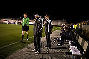 """March 14, 2009. Cary, NC.. The Carolina Railhawks went home in foul weather with a  1-0 victory over the New England Revolution of the MLS, in the inaugural """"Community Shield"""" match and their first professional outing under new coach, Martin Rennie. . Head coach Martin Rennie, center."""