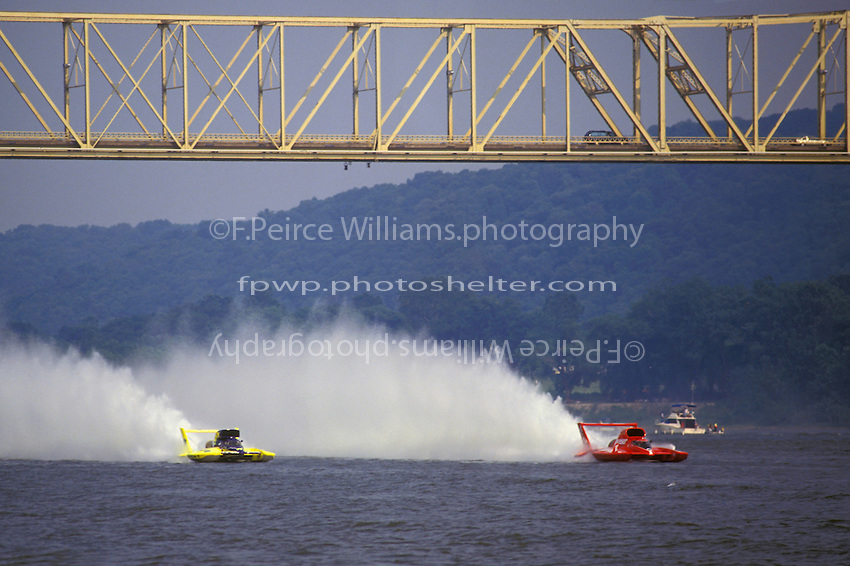 "(L toR): Mark Tate, U-10 Smokin' Joe's and Chip Hanauer, U-1 ""Miss Budweiser"" race under the Madiso-Milton Bridge."